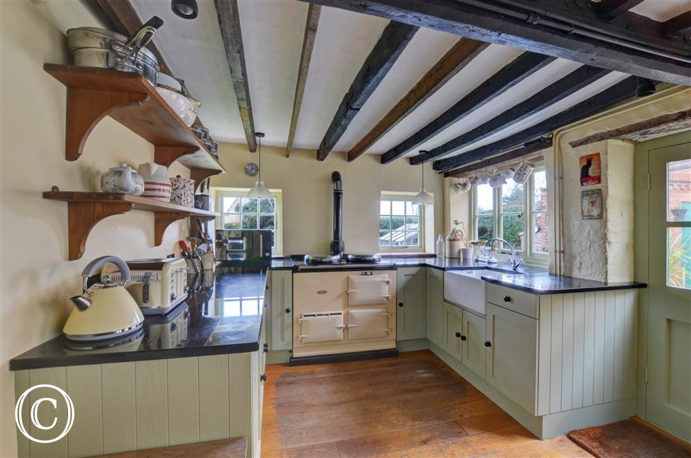Lovely kitchen with rustic open beams