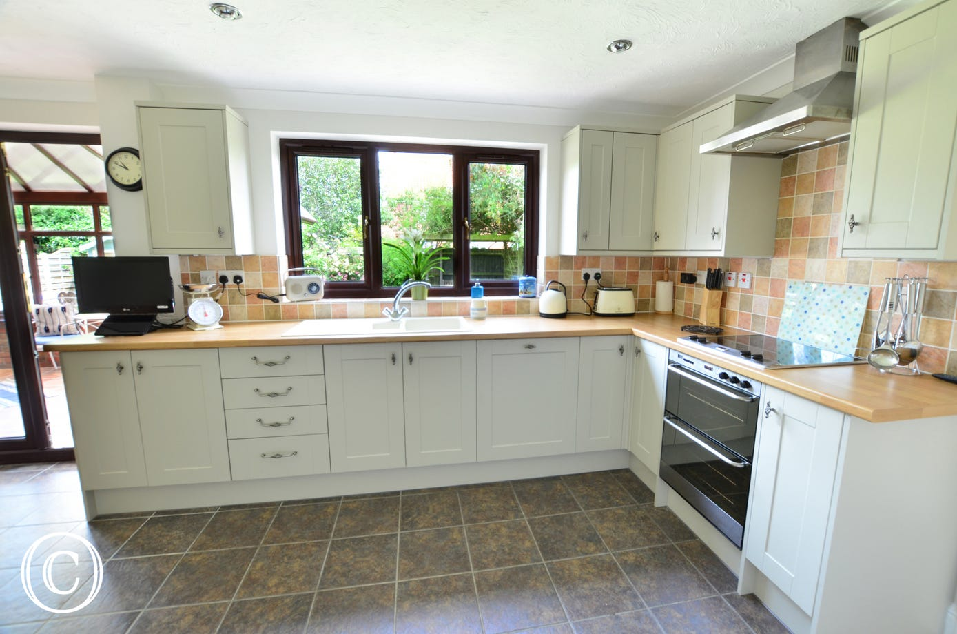 Bright and contemporary kitchen with views to the garden with the added bonus of an utility room and ground floor Cloakroom