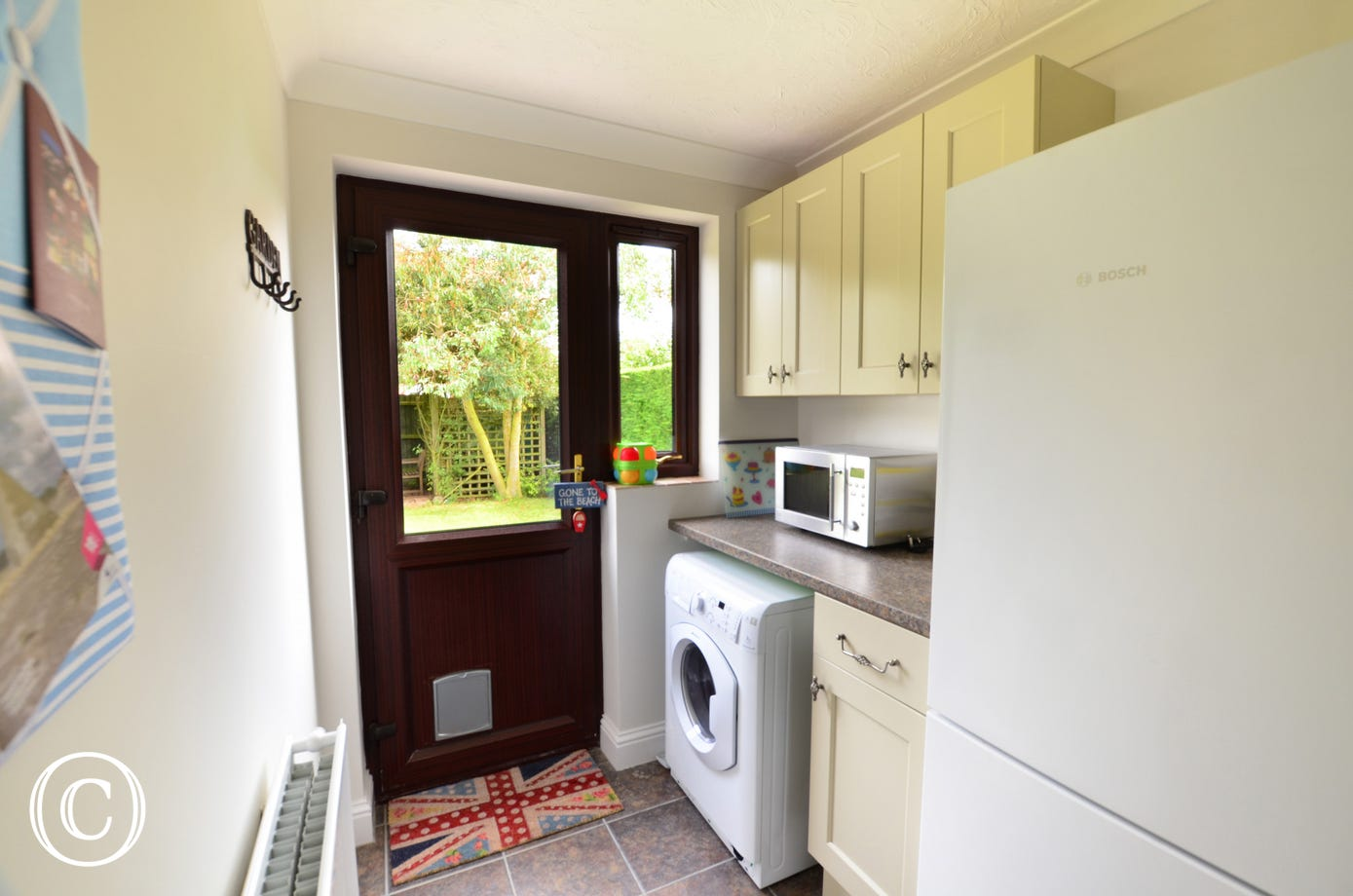 Very useful utility room with door to the garden