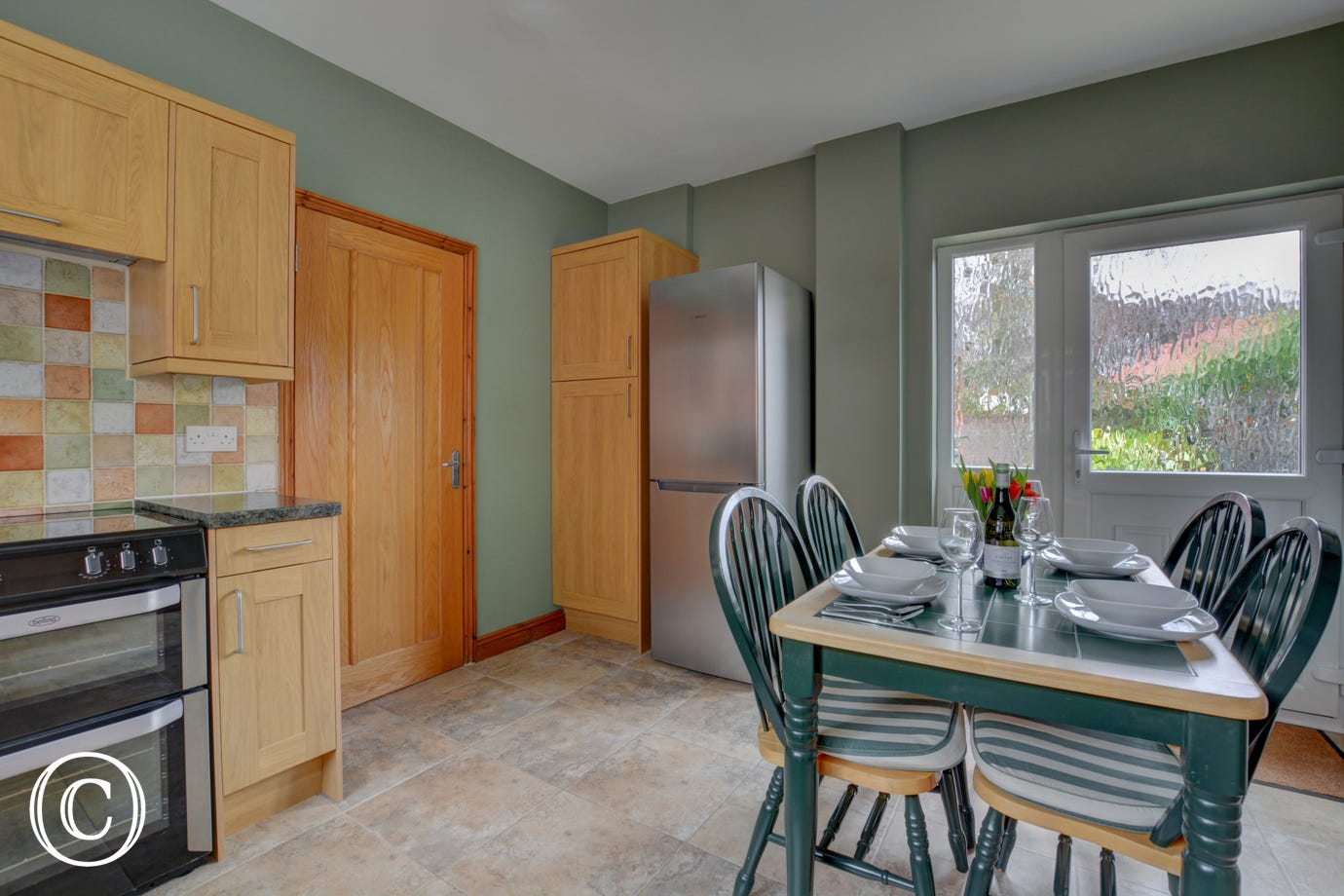 Kitchen and dining area with table and chairs for 4 people.