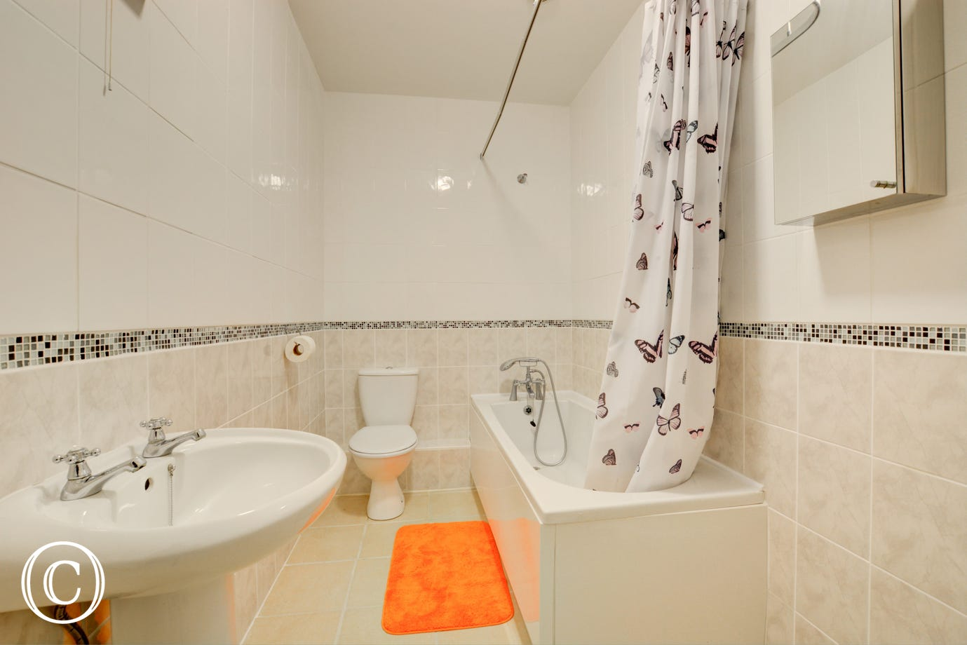 Bathroom with bath and hand held shower