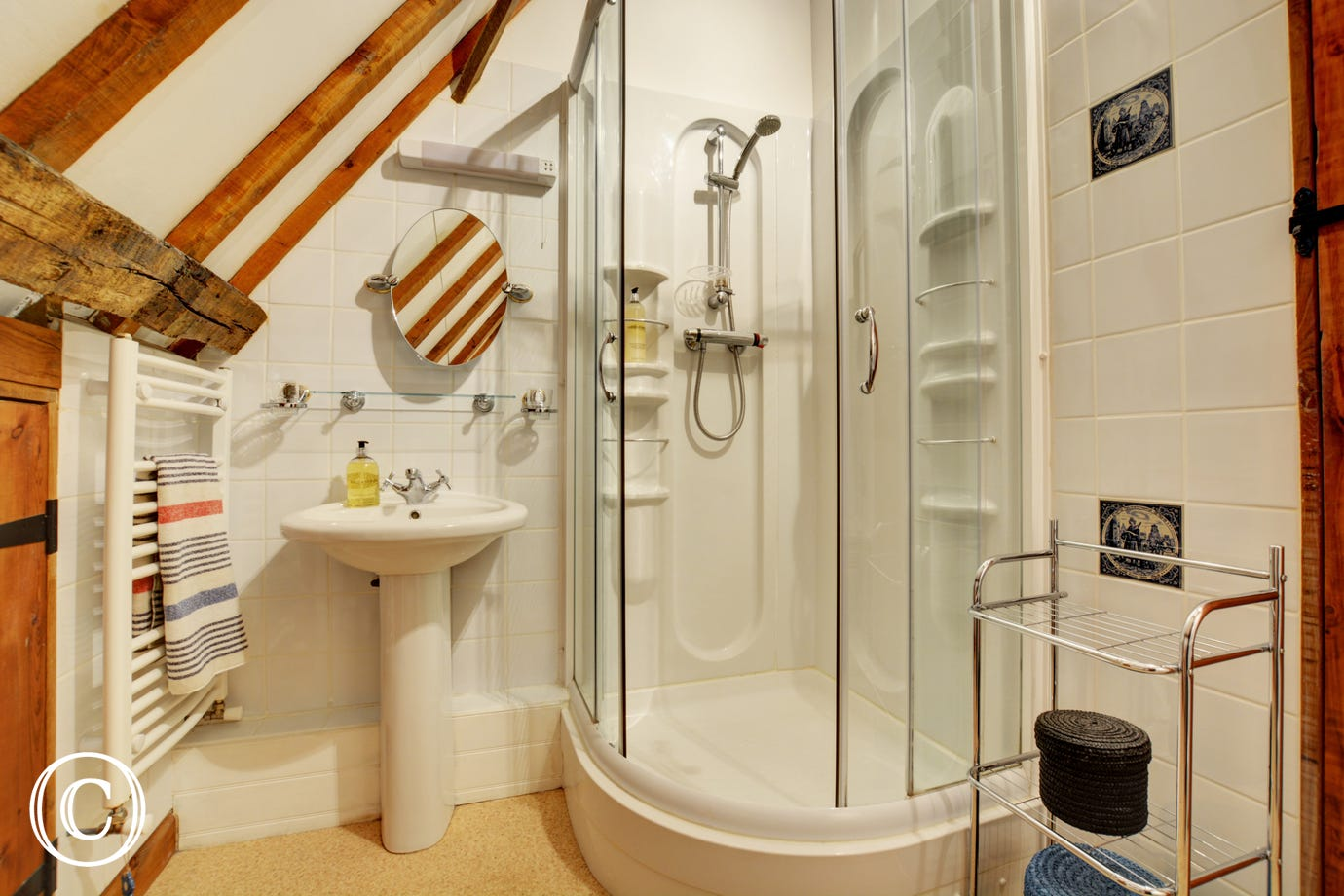 The bathroom also benefits from a separate shower cubicle