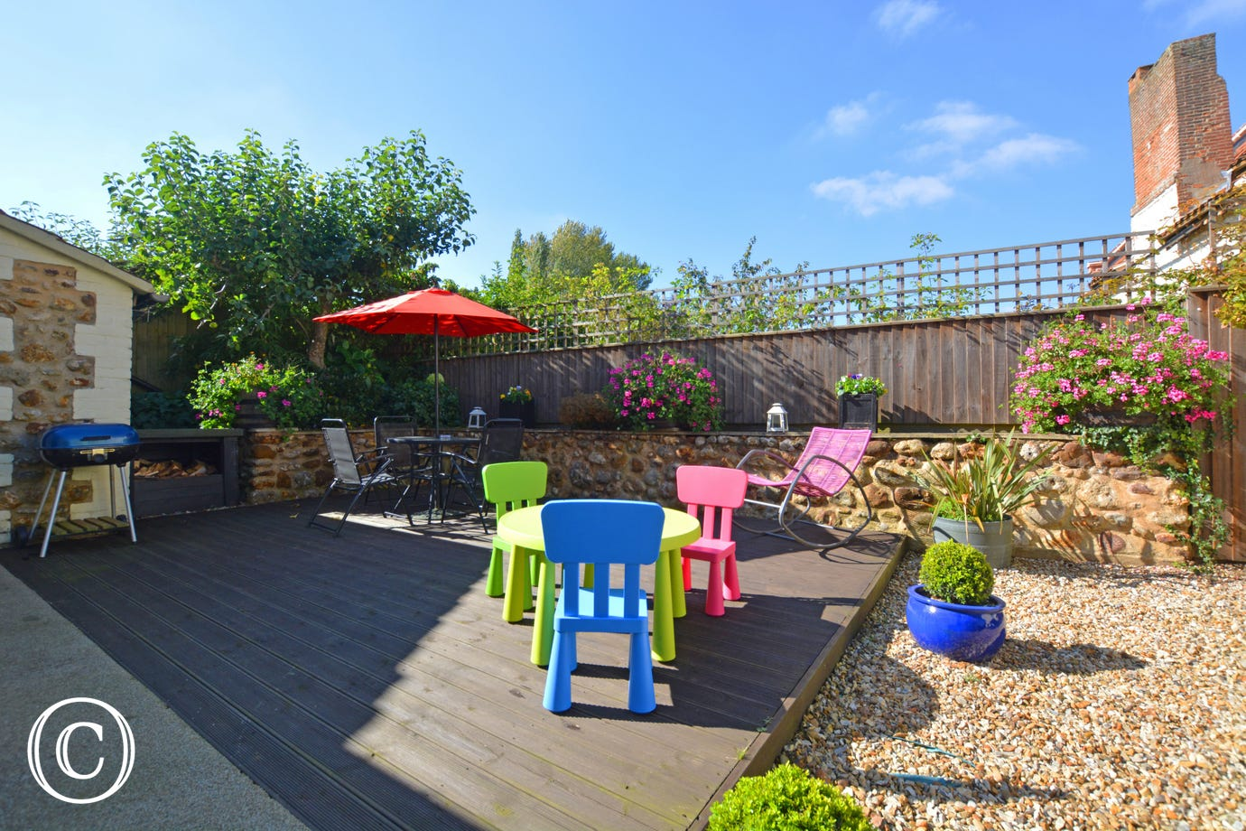 Rear garden with large patio and decking area