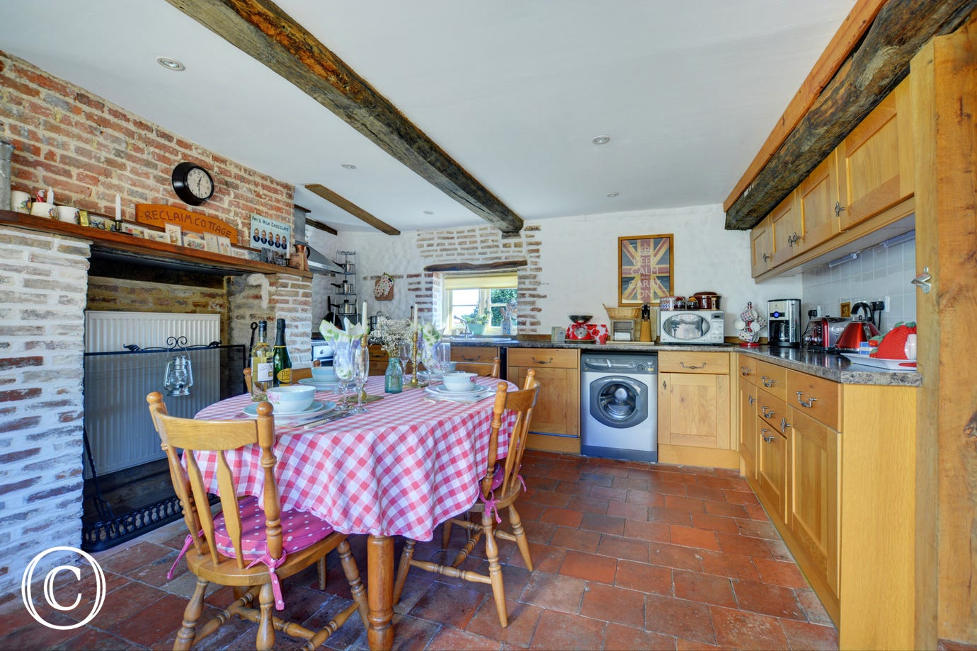 Large spacious farmhouse style kitchen with all  the major appliances and a dining area