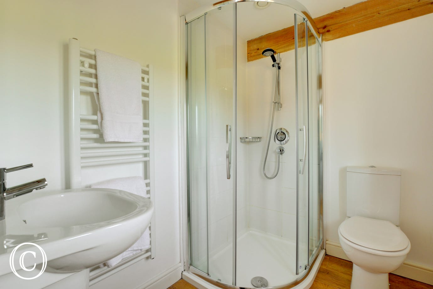 Light and modern en-suite shower room.