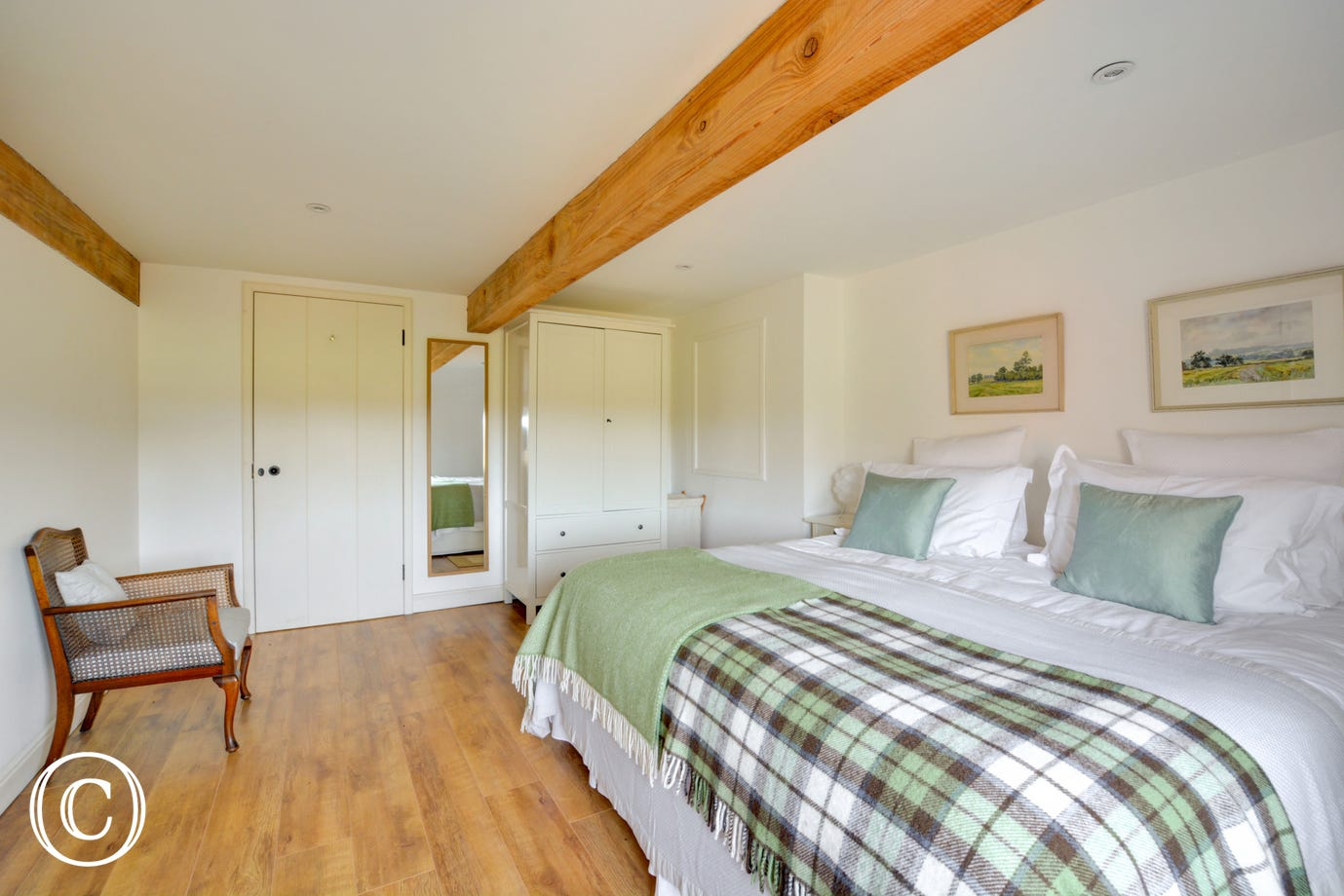 With the luxury of an en-suite, a bright and airy bedroom.