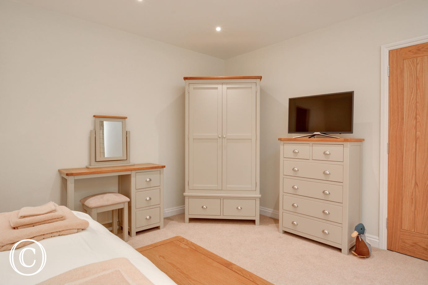 View of bedroom furniture and TV