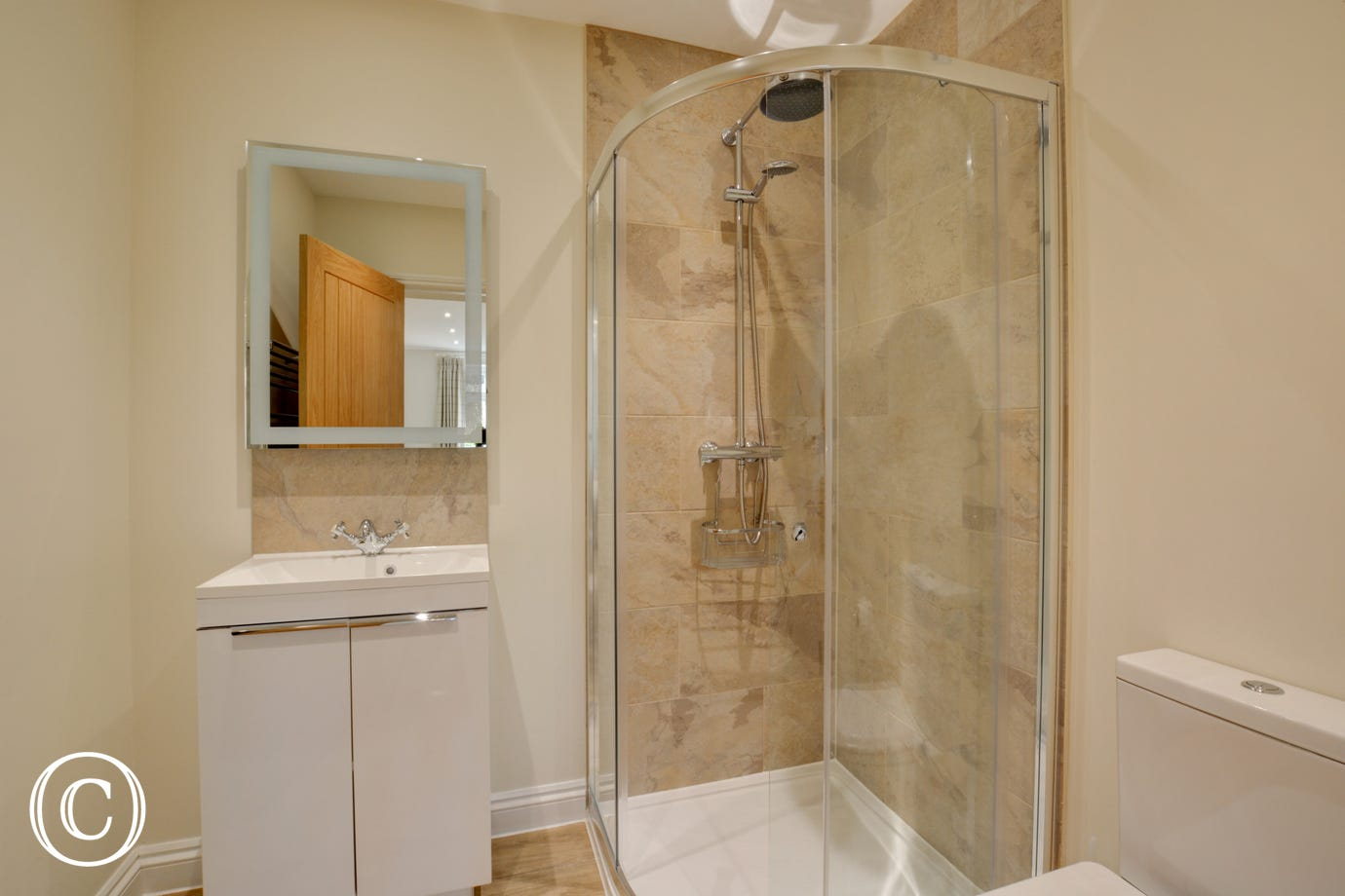 Walk-in shower and vanity unit