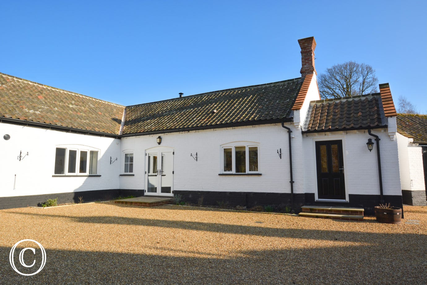 Exterior of Cottage with gravelled area