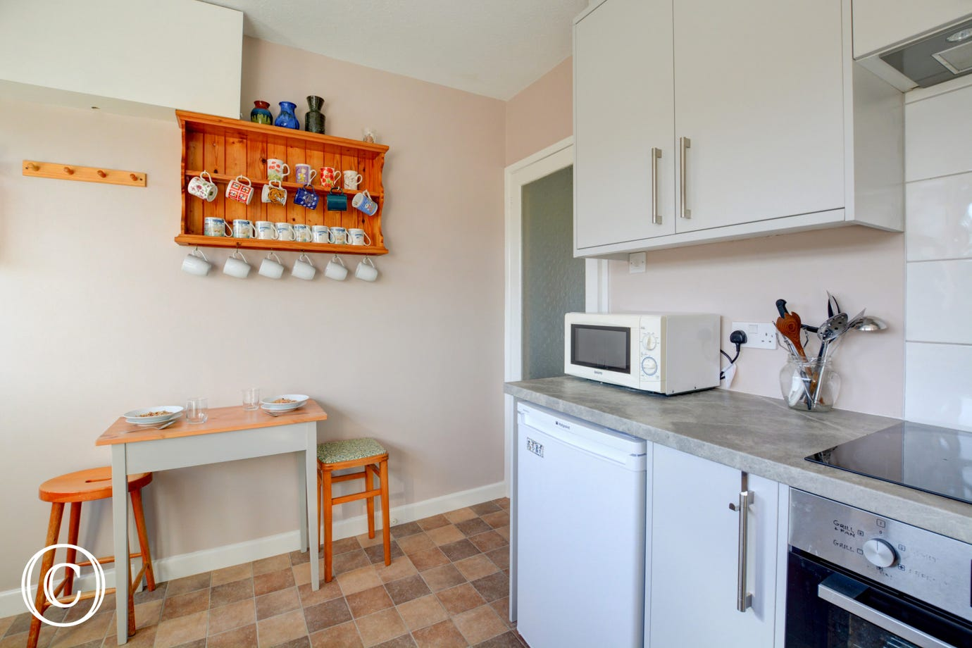 There is a small dining area within the kitchen.