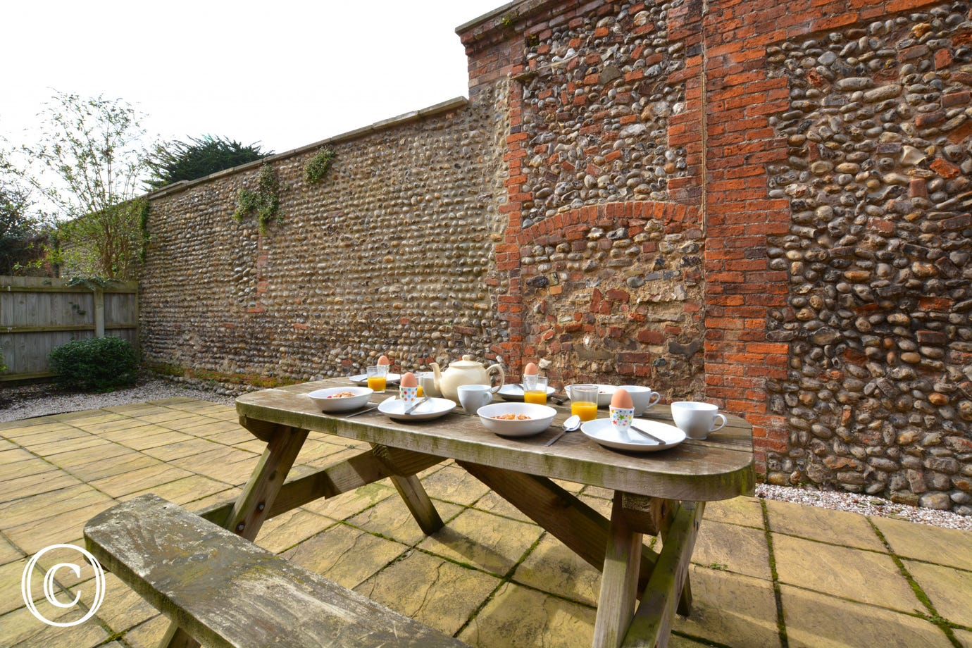 Enclosed courtyard with picnic table.