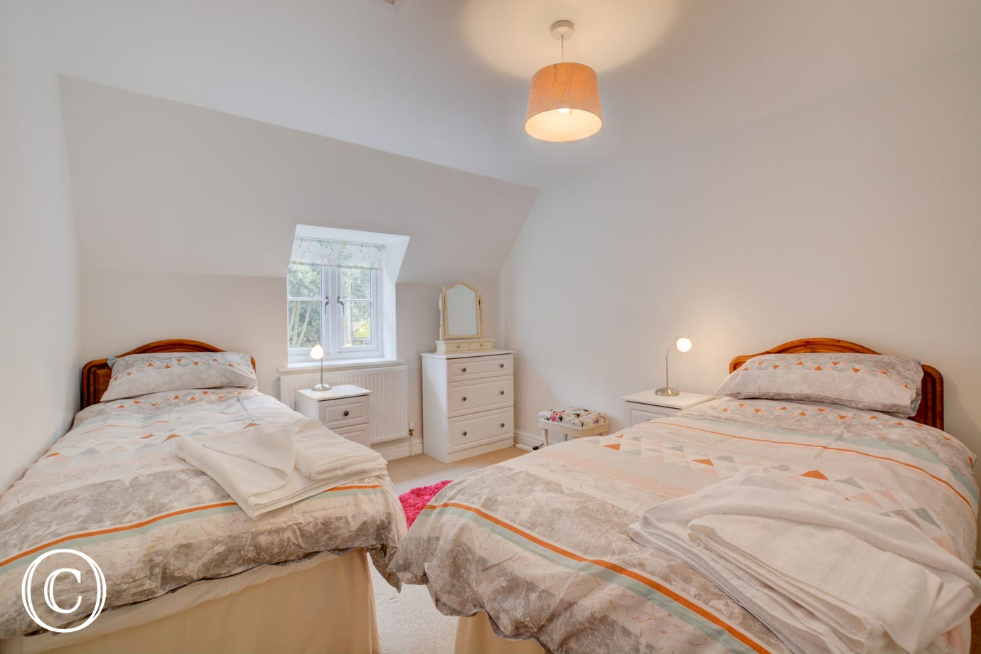 Twin beds with chest of drawers & bedside tables