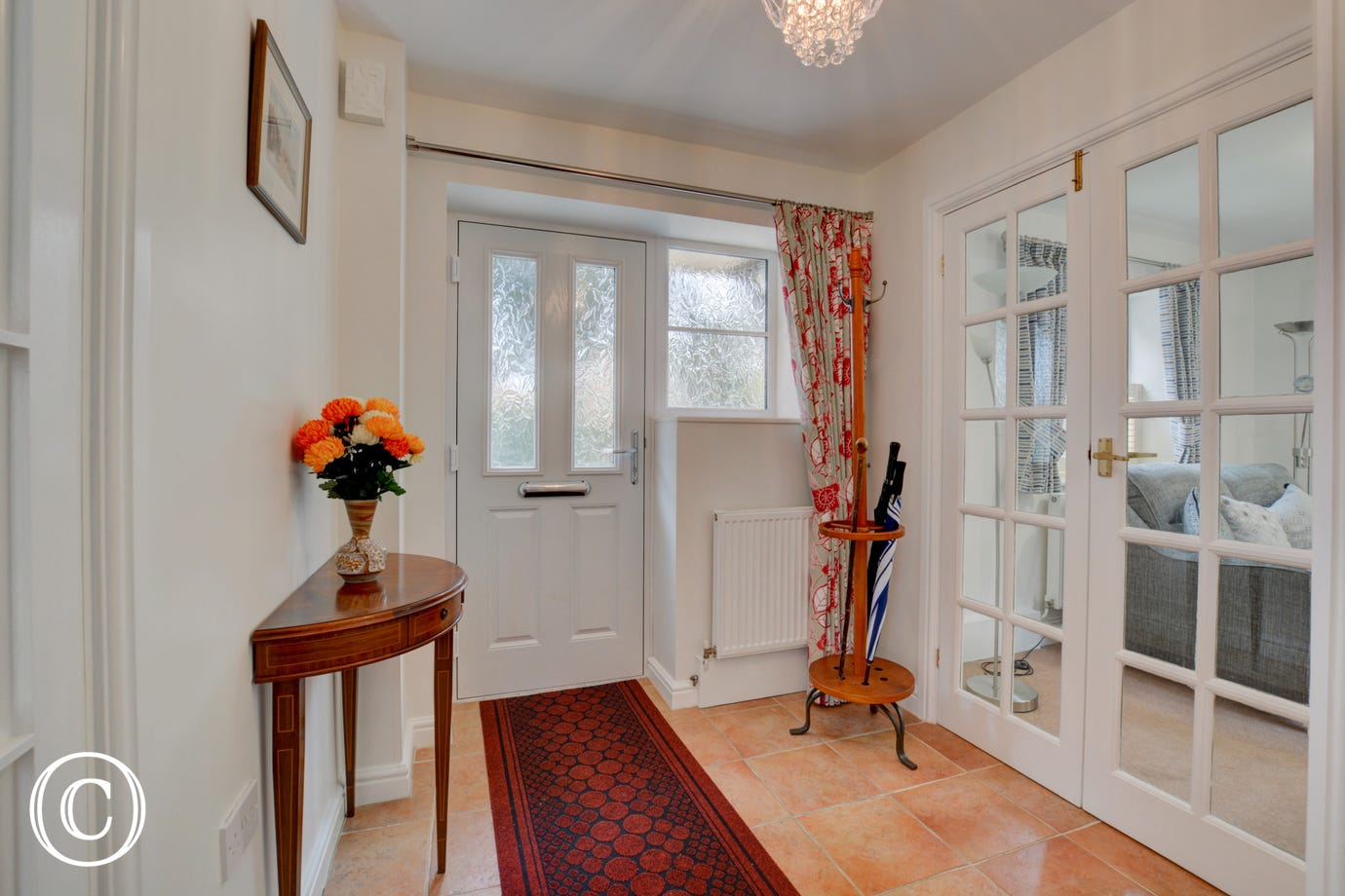 Entrance Hall with french doors into sitting room