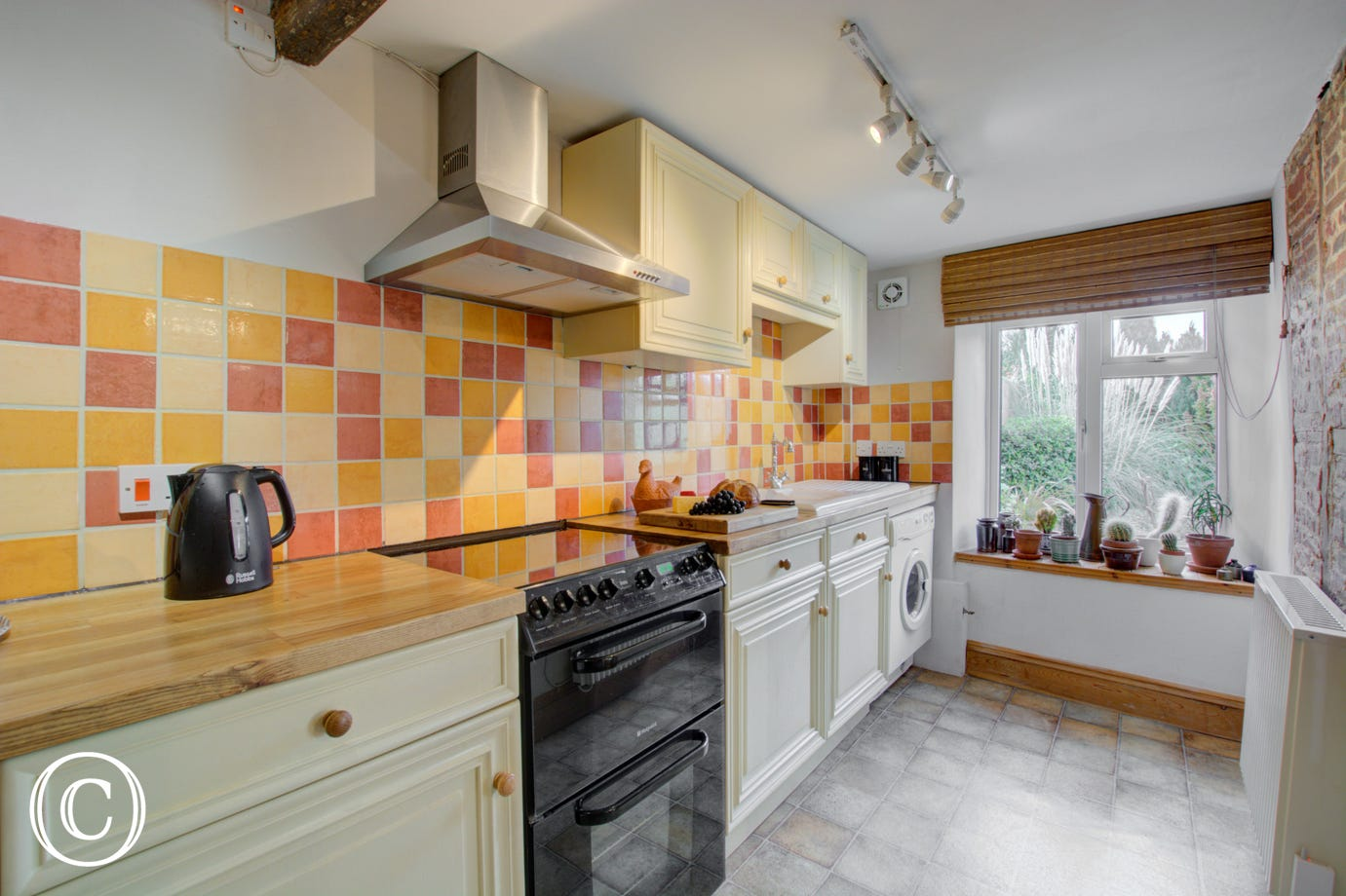 Well equipped kitchen with ample cupboard space