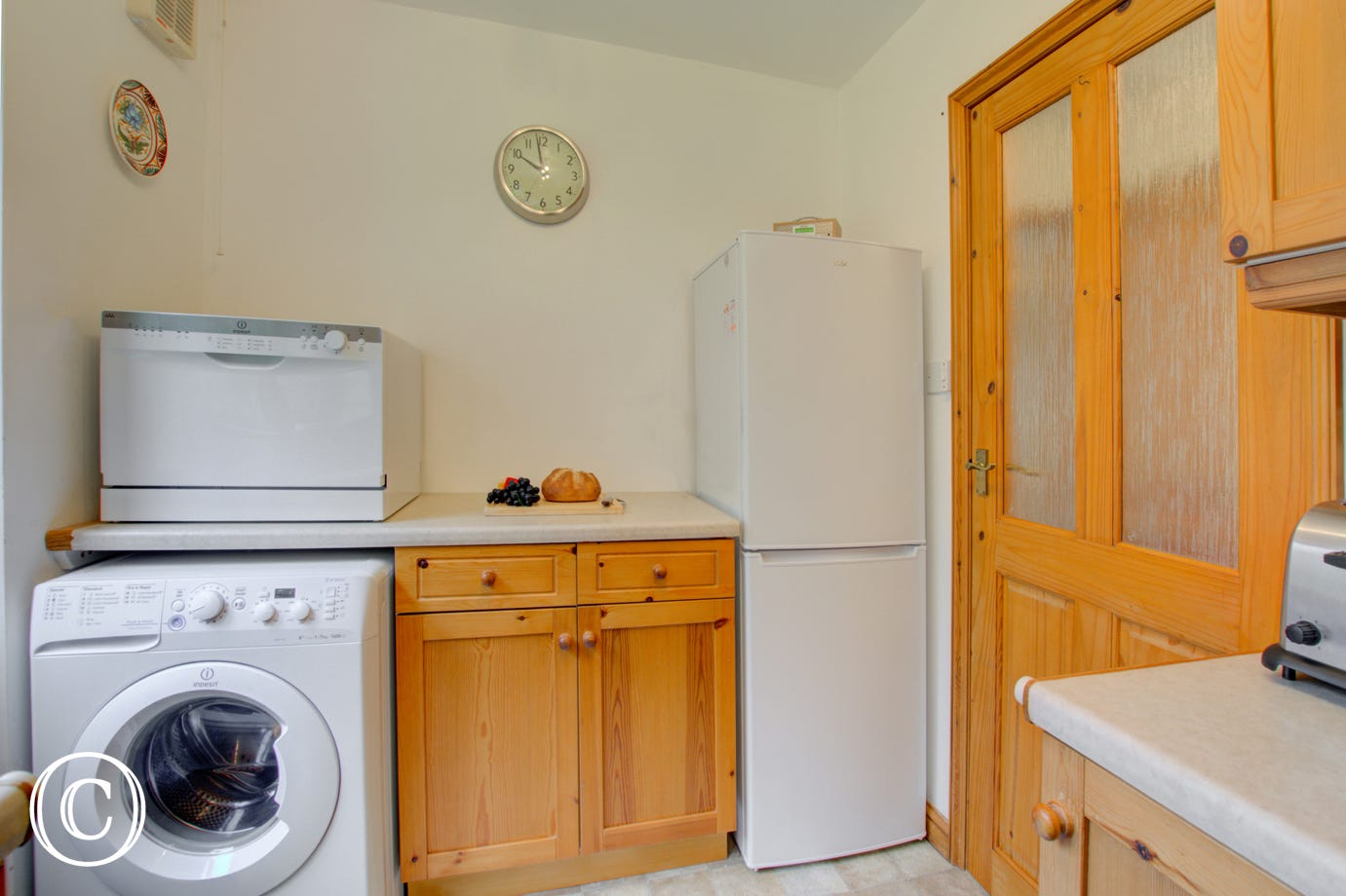 Kitchen showing fridge freezer and washing machine