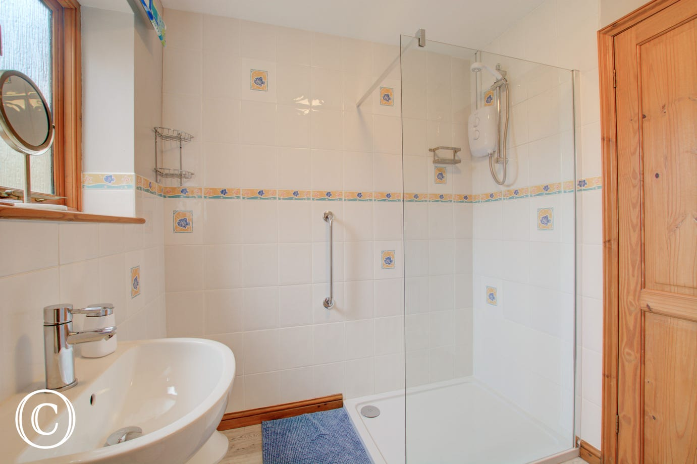 Bright, fully tiled shower room