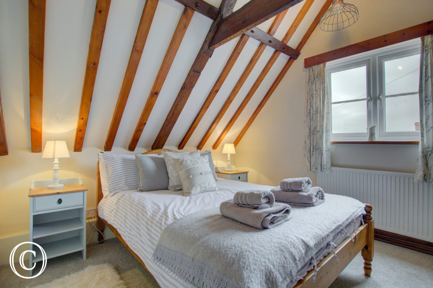 Main bedroom with lovely open beams and double bed