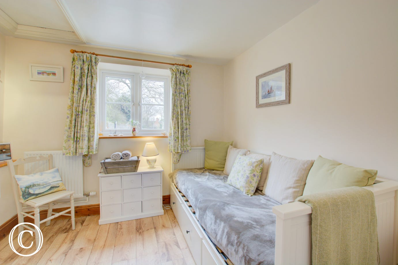 This property also has a delightful cosy 'snug' room