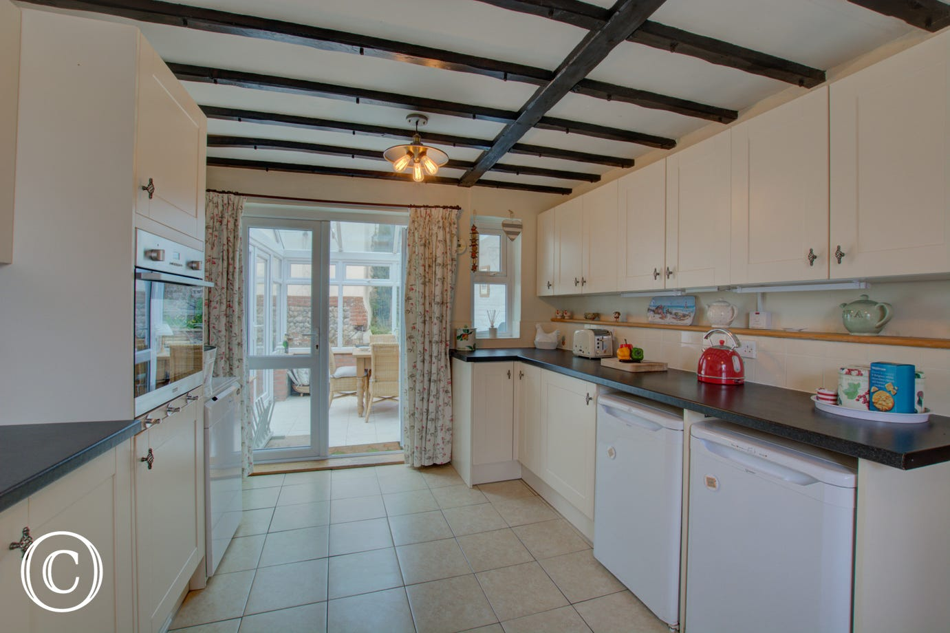 Spacious kitchen with electric oven and hob