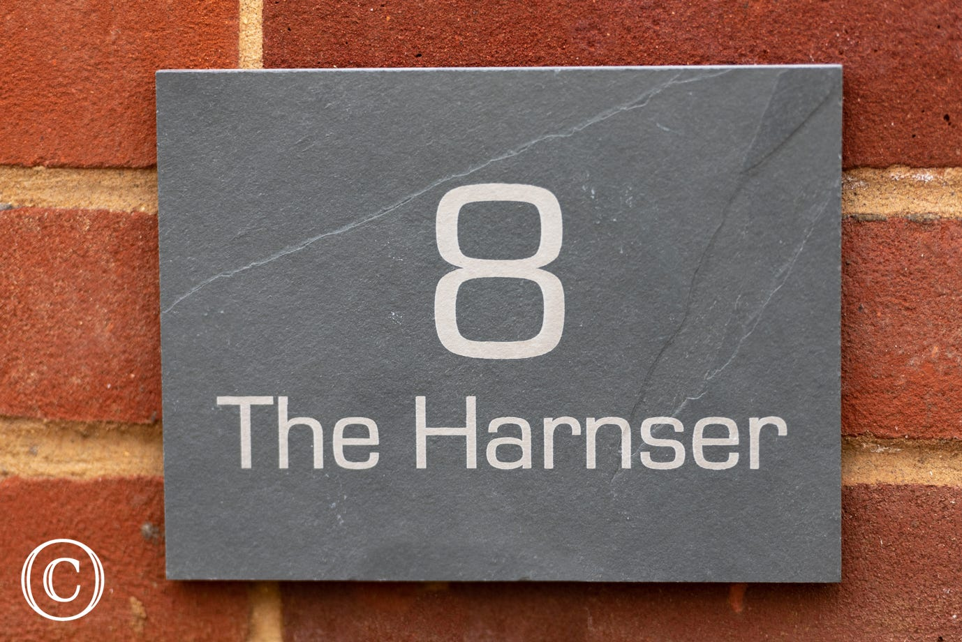 The Harsnser - Nameplate