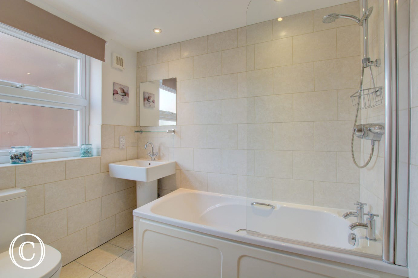 Sparkling white bathroom, heated towel rail.