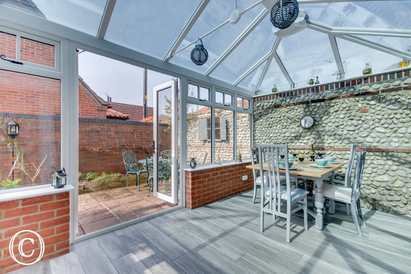 Conservatory with dining table & chairs