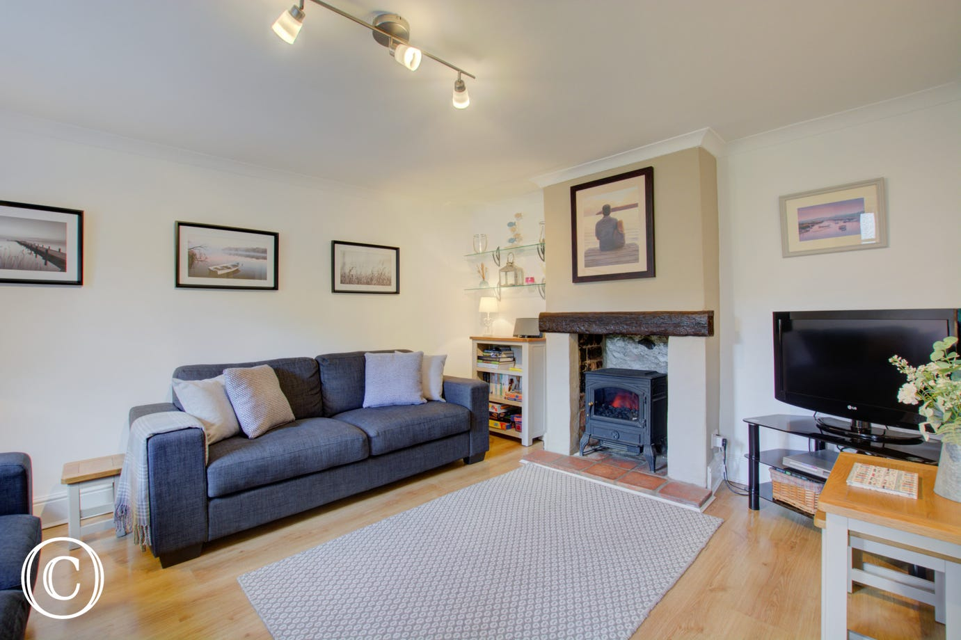 Cosy Sitting Room with comfortable furnishings, woodburner and TV