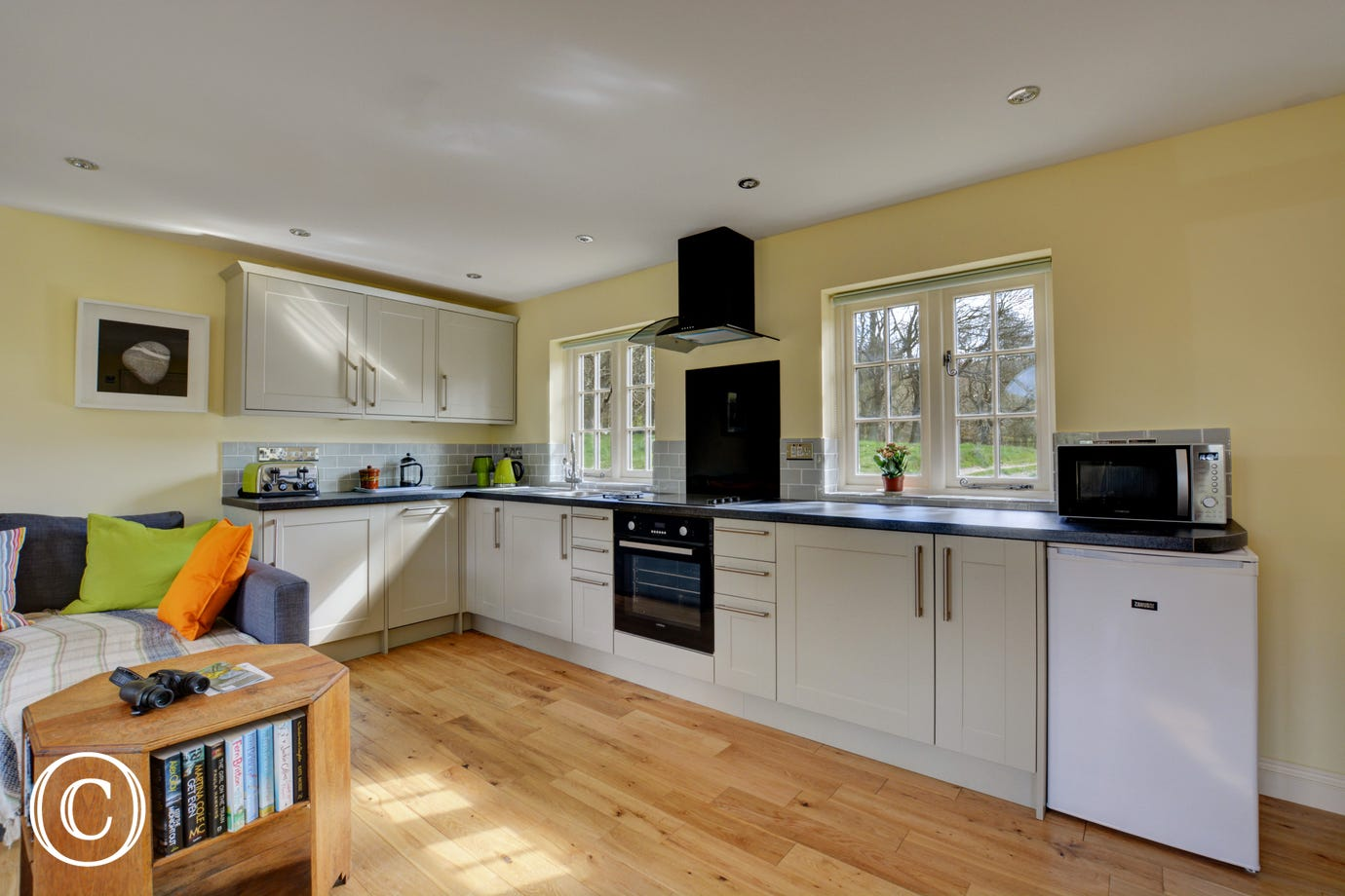 Social open plan kitchen area built in electric oven, electric hob, microwave, fridge with ice box, freezer, dishwasher, washer/dryer