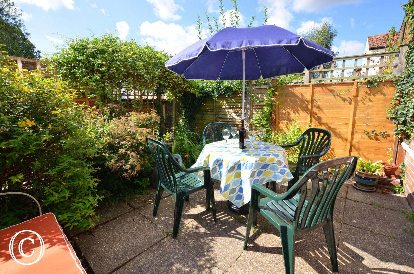Patio garden - a suntrap, ideal for dining outside on a warm summers evening