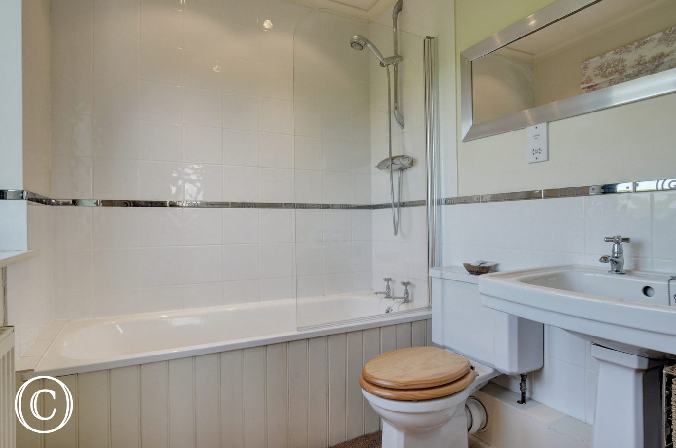 En-suite, bath with shower over, washbasin and wc