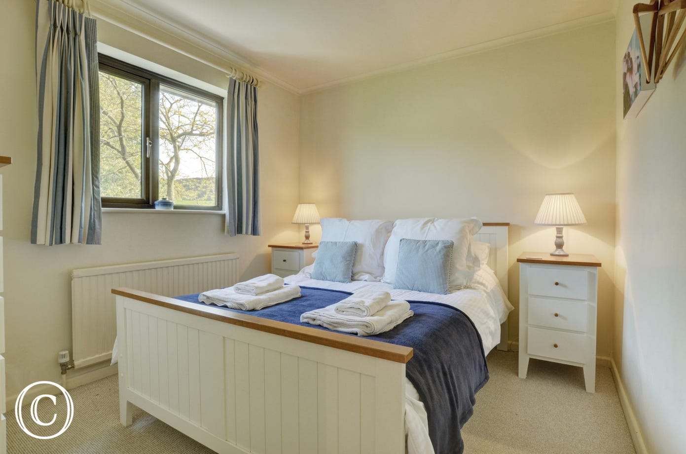 Cosy, double bed with bedside tables