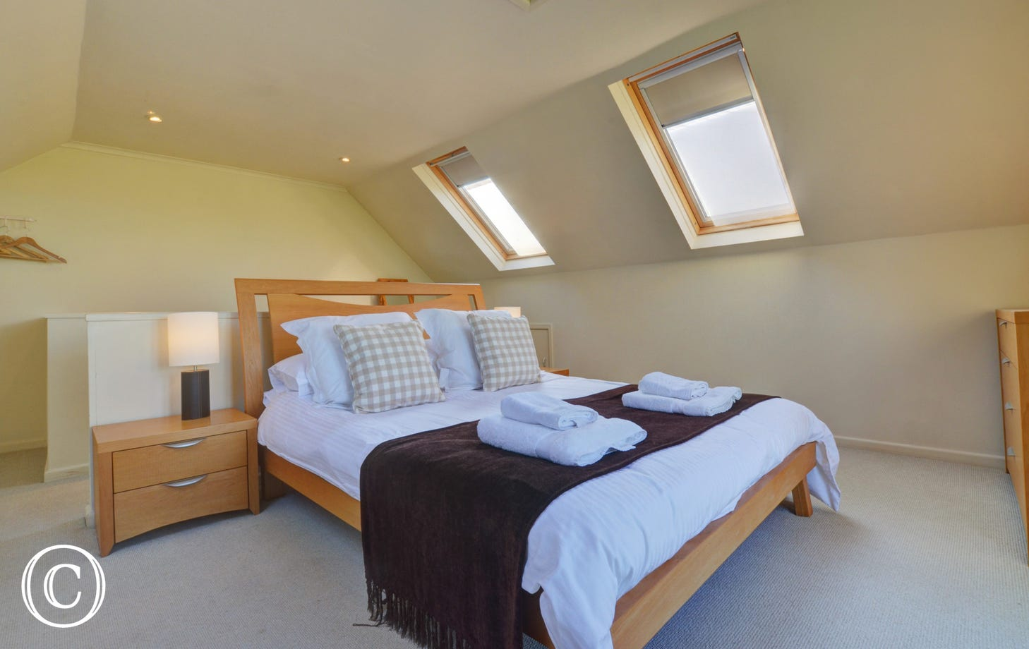 Light and airy with double bed and bedside table