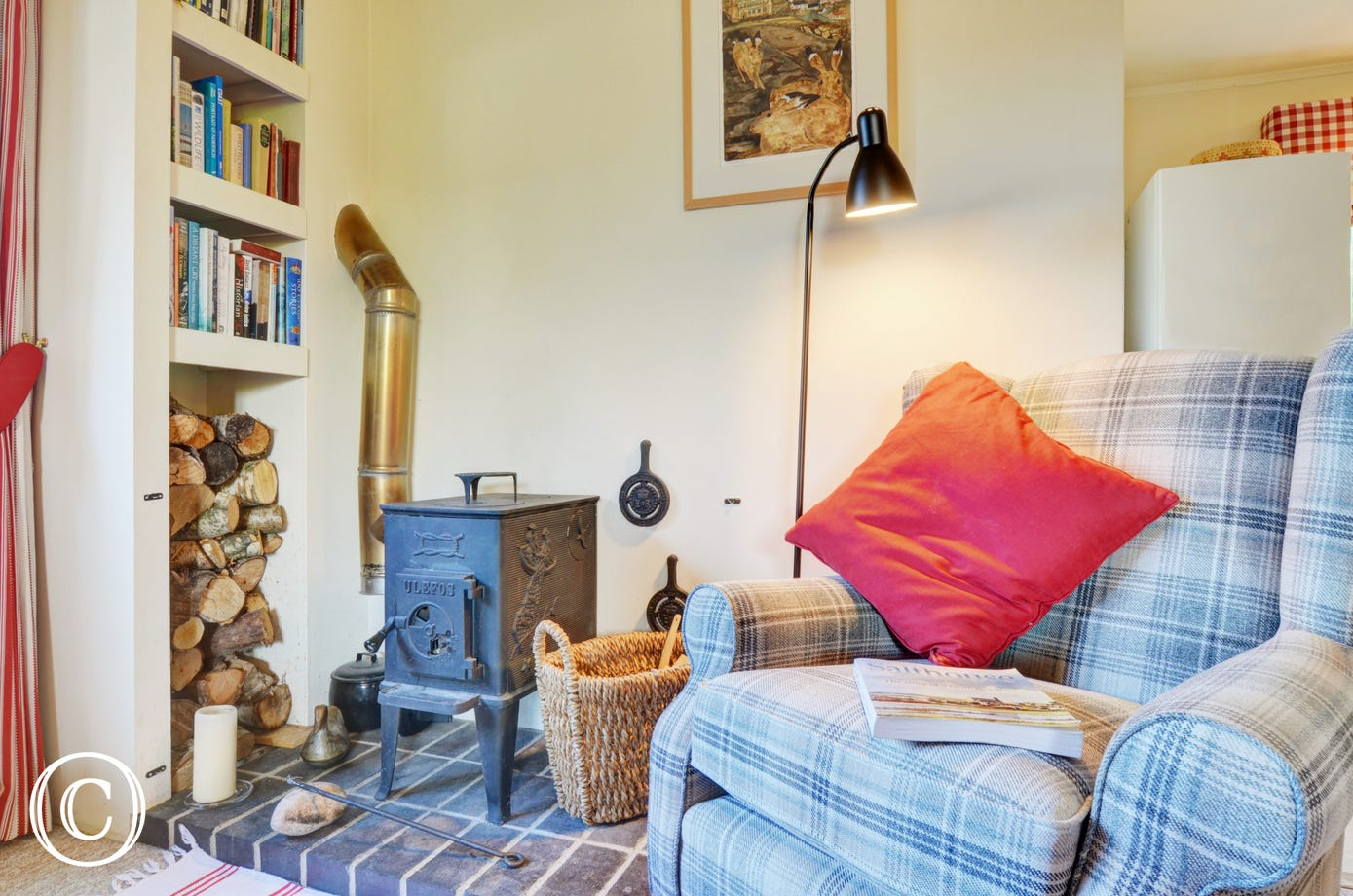 Cosy chair next to woodburner