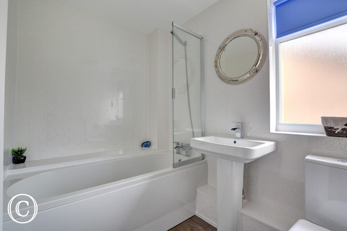 Bath with shower over, washbasin and wc