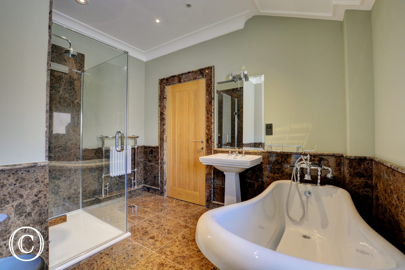 En-suite with bath, separate shower cubicle, washbasin and wc