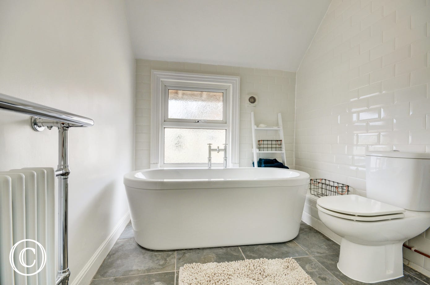 Bathroom with bath, separate shower cubicle, washbasin and w.c