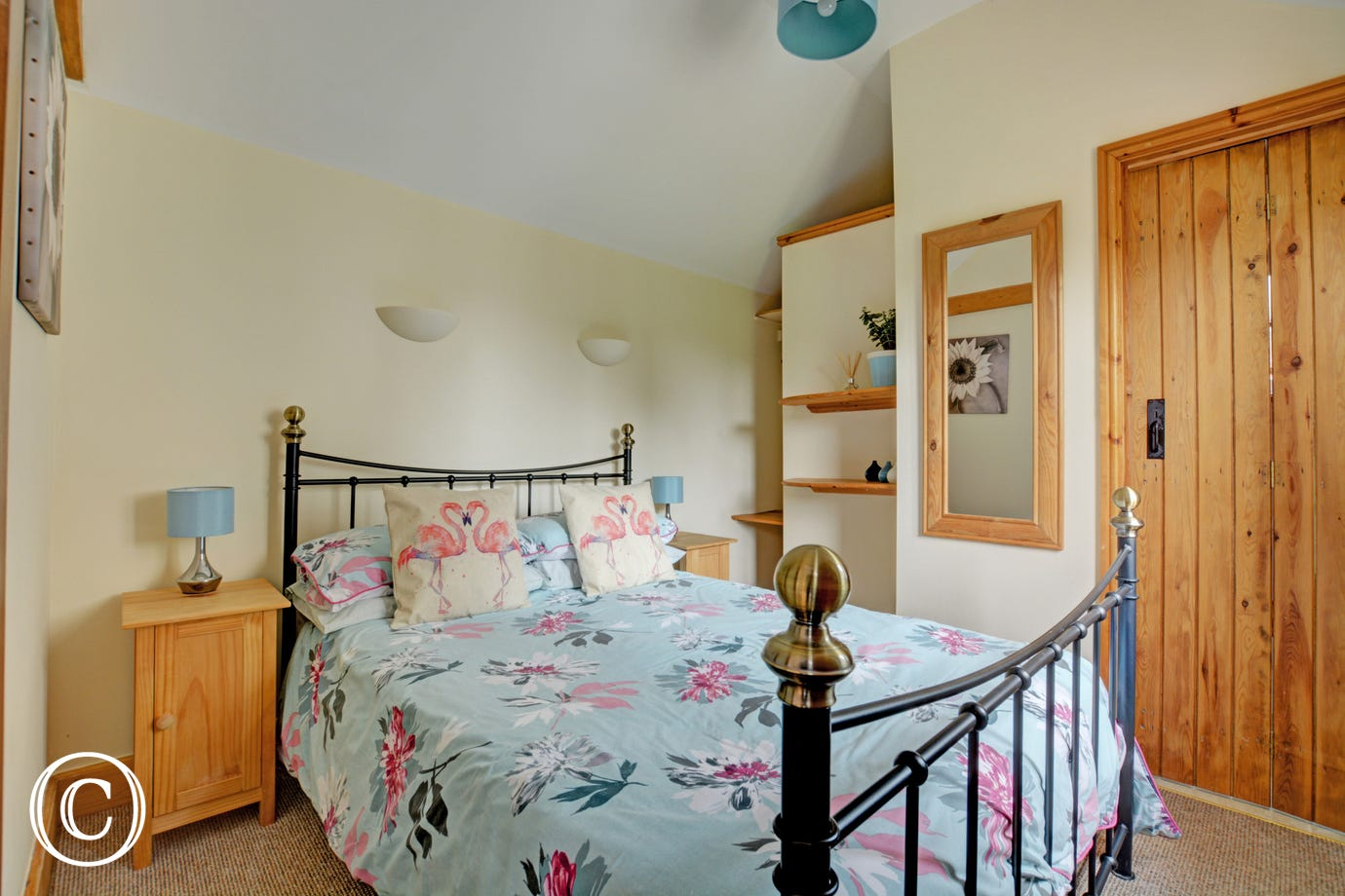 Pretty double bedroom with wrought iron double bed and en-suite shower room
