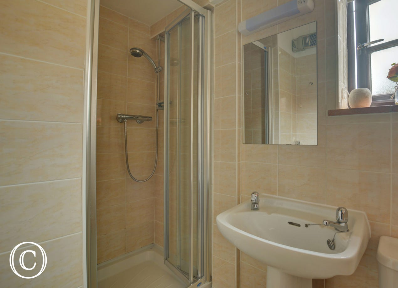 Modern en-suite shower room with shower cubicle