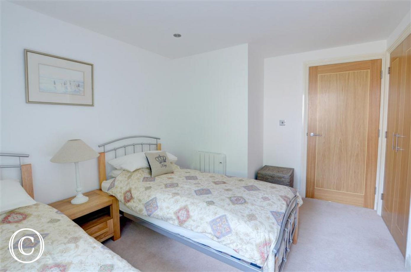 This view shows the twin beds and stylish wood doors