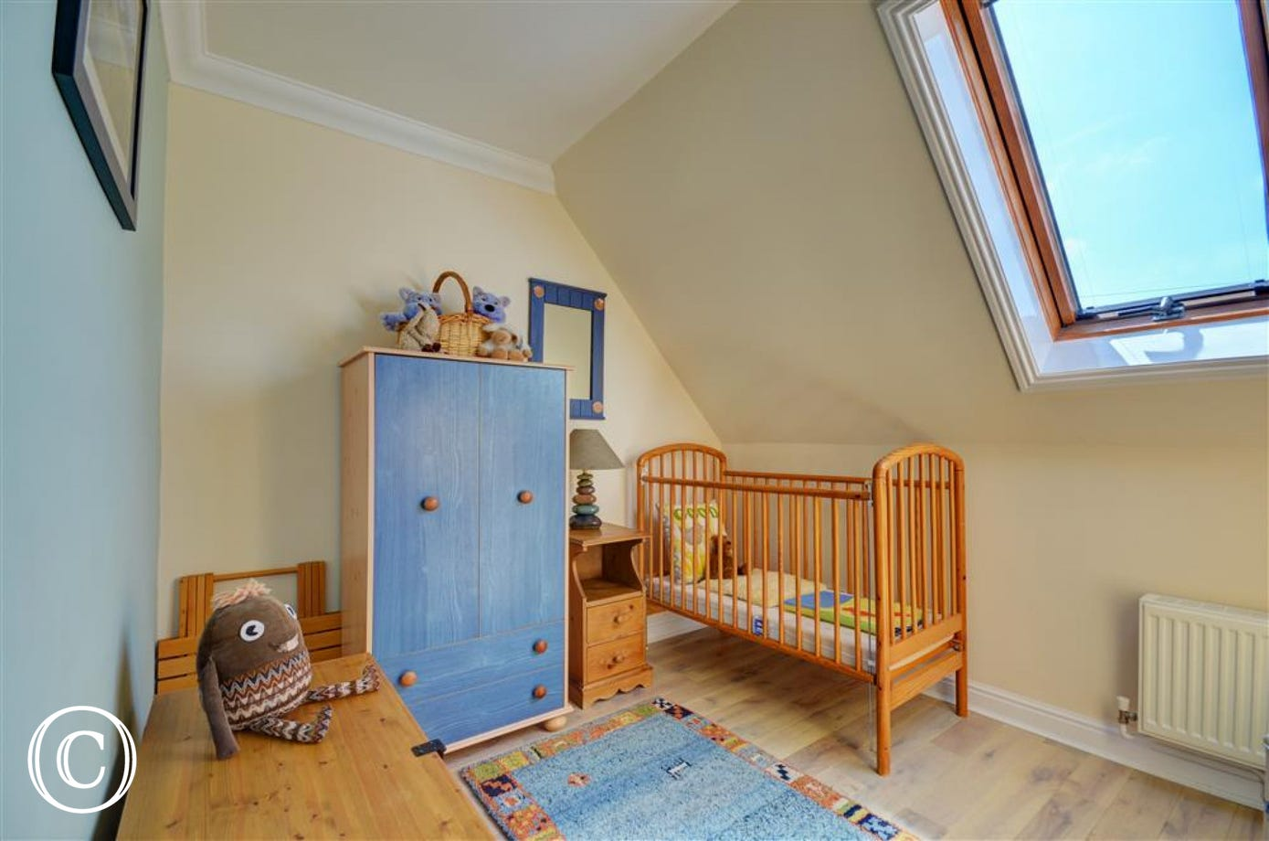Bedroom three has a full sized cot