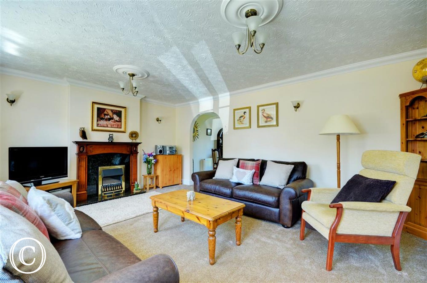 The sitting room is large enough for all guests to relax after a long day of sight seeing