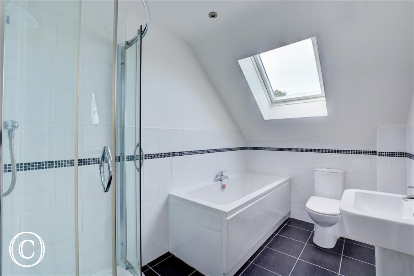 Lovely modern bathroom with bath and seperate shower cubicle