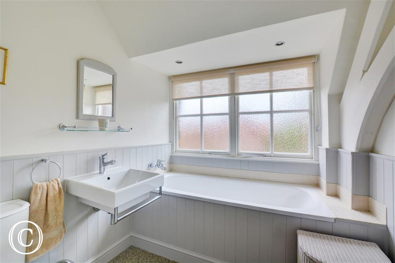 First floor bathroom with bath and wash basin