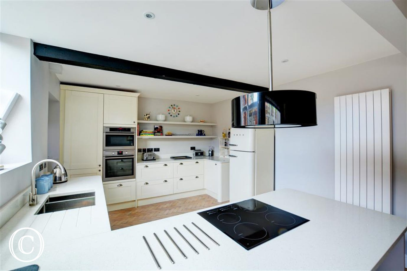 Spacious kitchen with electric hob and oven