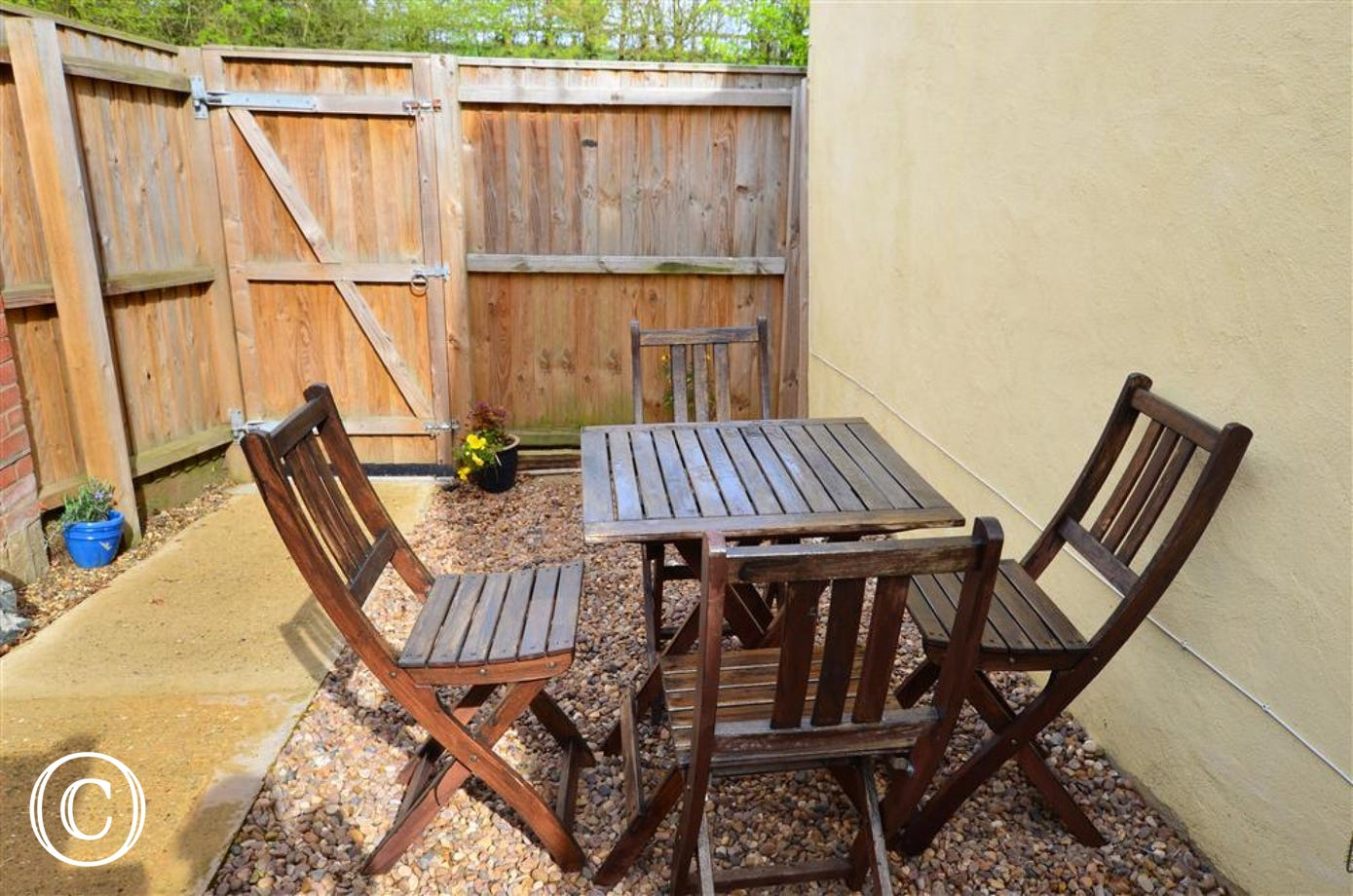 The rear courtyard and patio furniture