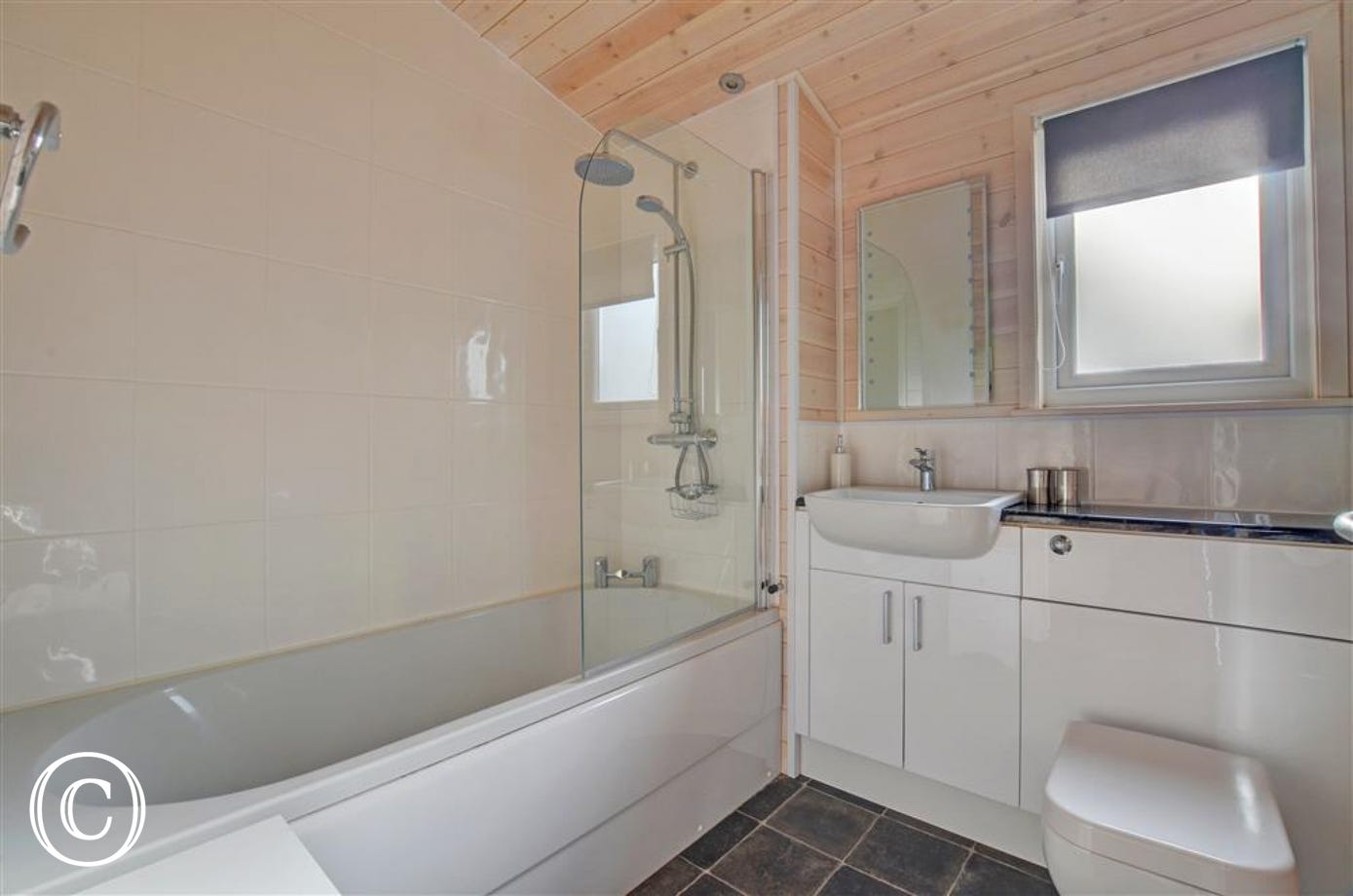 Lovely bathroom with bath and overbath shower