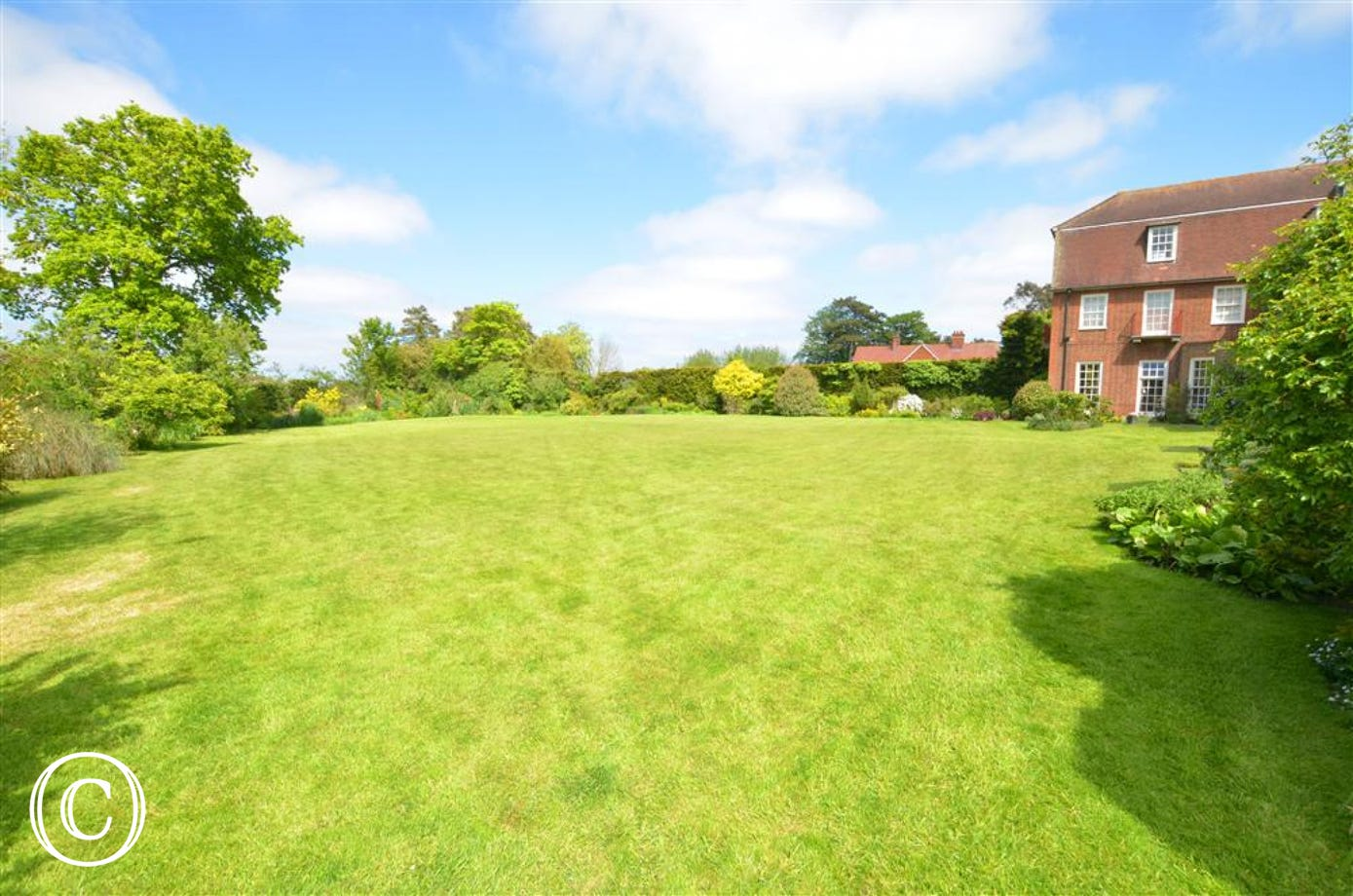 A spacious communal garden that is immaculately maintained