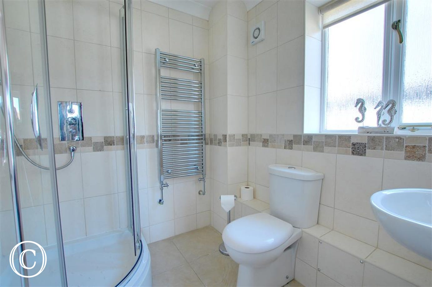 En-suite bathroom with shower cubicle, wc and wash hand basin.