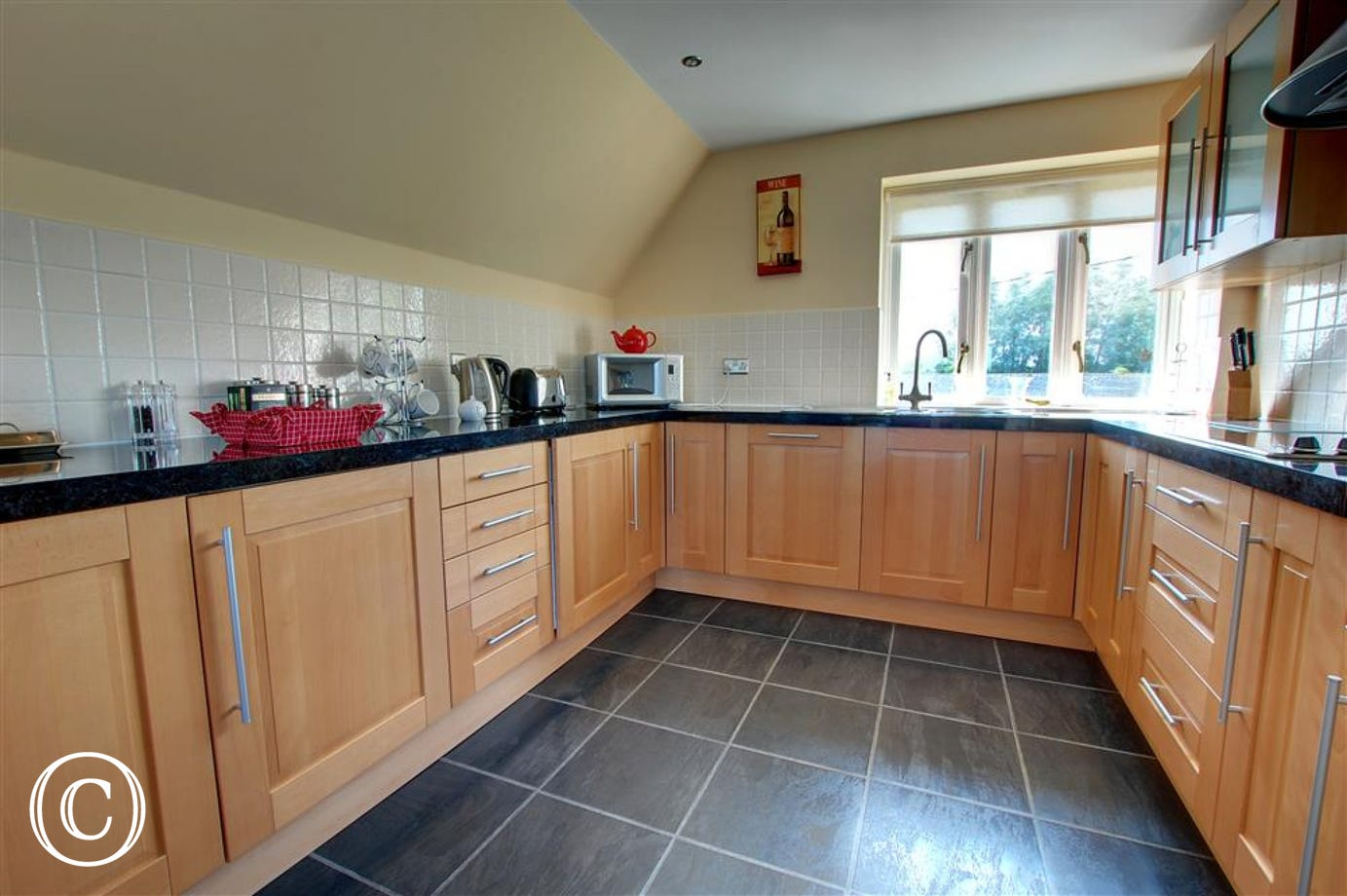 Kitchen area with a good range of base level units.