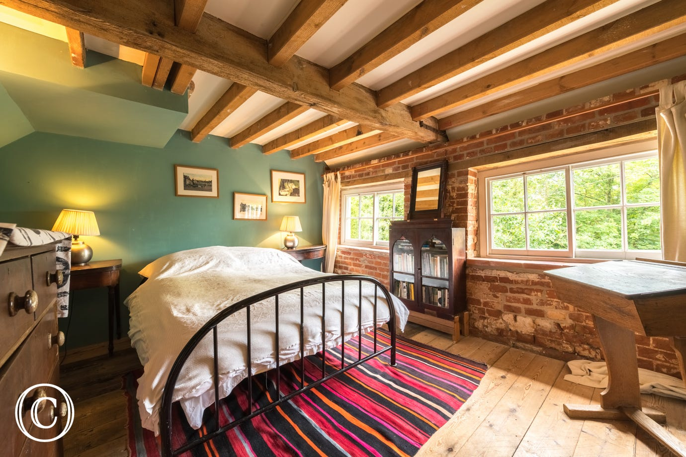A double bedded room with pretty views over the mill pond